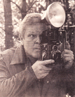 "Caption: Douglas Hamm checks the view through the ""old crank"" the first camera he bought several years ago. Hamm has is a recognized artist in commercial and art photography."