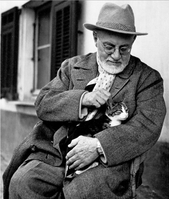 Artist Henri Matisse and his cat Minouche.